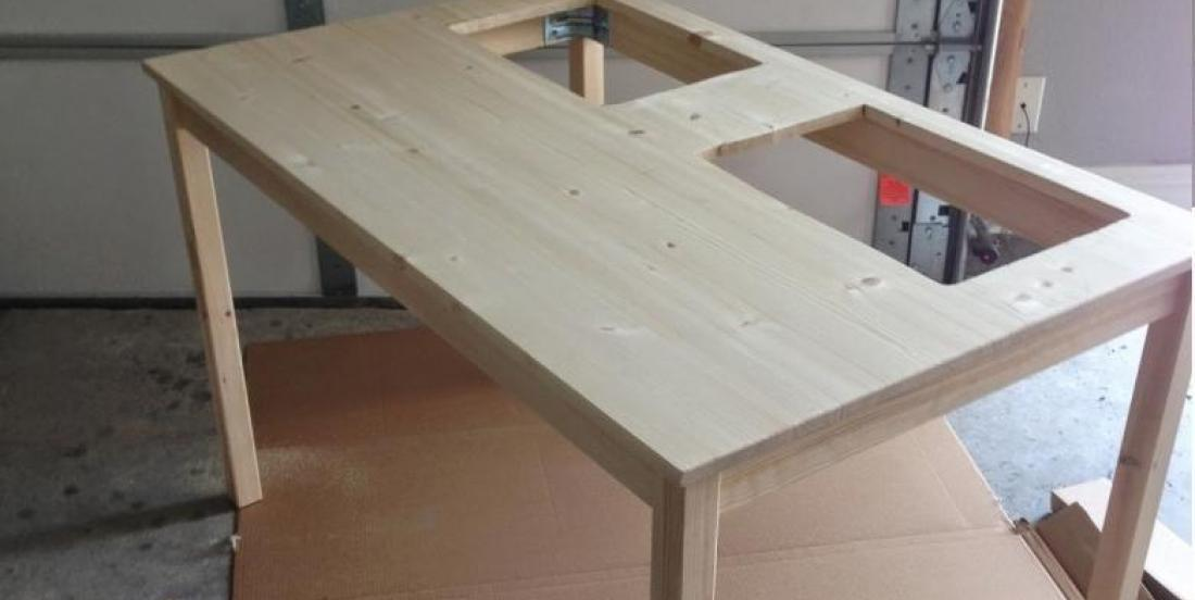 She makes 2 holes in an Ikea kitchen table! Her idea is absolutely brilliant!