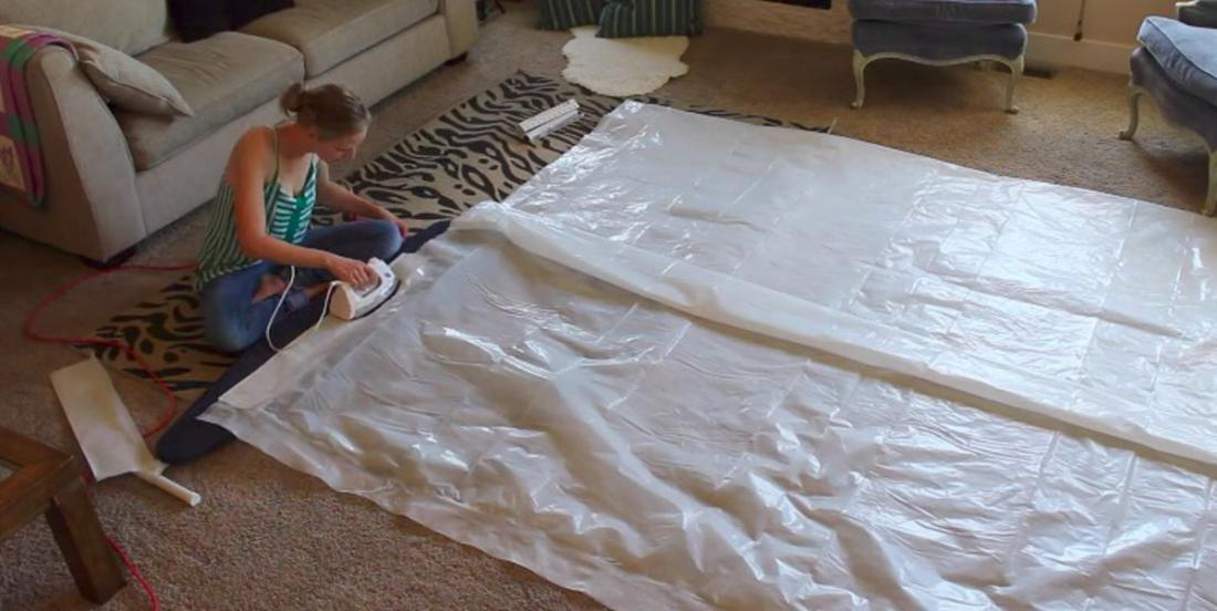 This mom is ironing a large piece of plastic! What she is creating for her children is priceless!