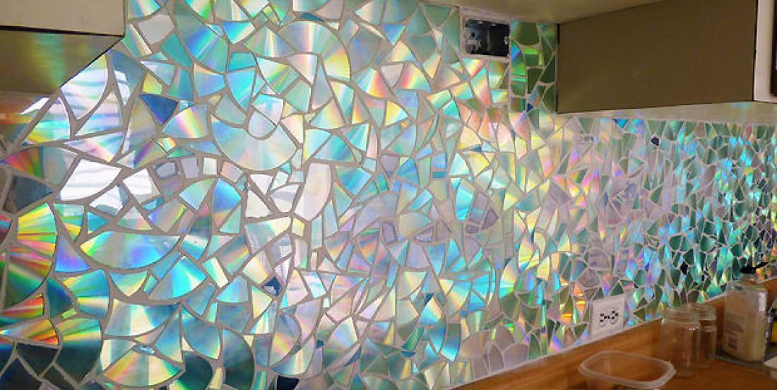 She uses CDs to make a backsplash in her kitchen ... This is awesome!