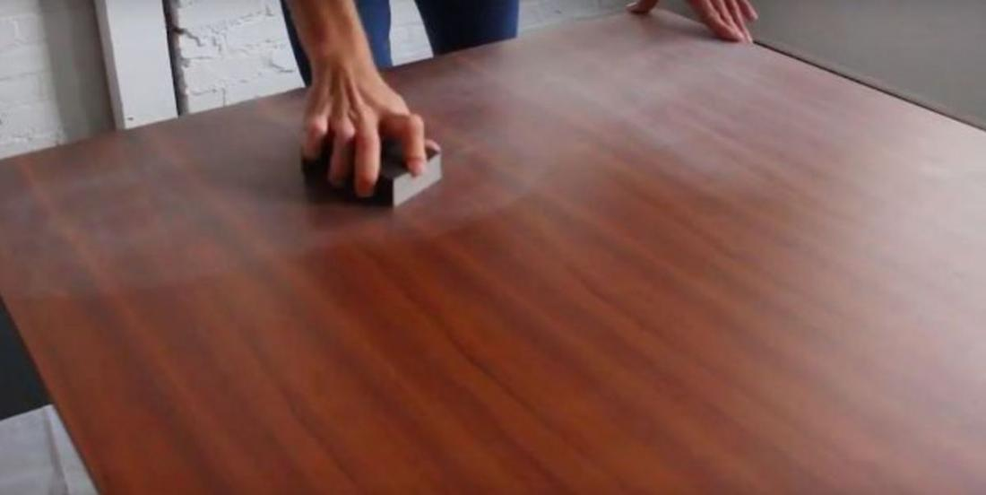 The first thing he does when he gets his new table is to sand it! And it's a great idea!