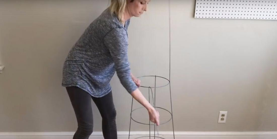 She uses a tomato cage to create a decoration for her house!