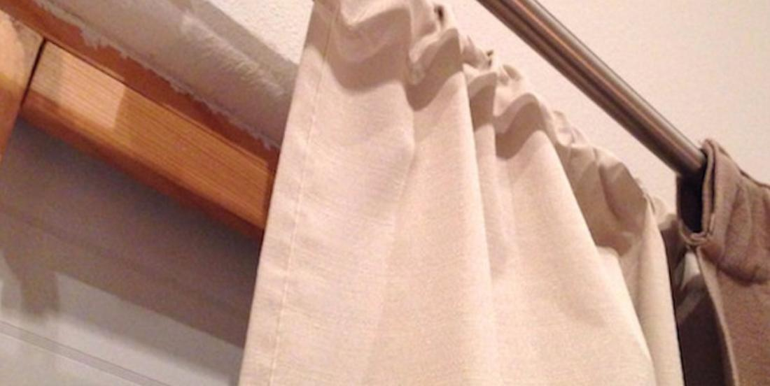 What she uses to double her curtain for winter is so clever! And it costs almost nothing!