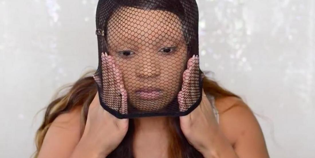 She puts a fishnet stockings on her head, and creates the perfect makeup for Halloween