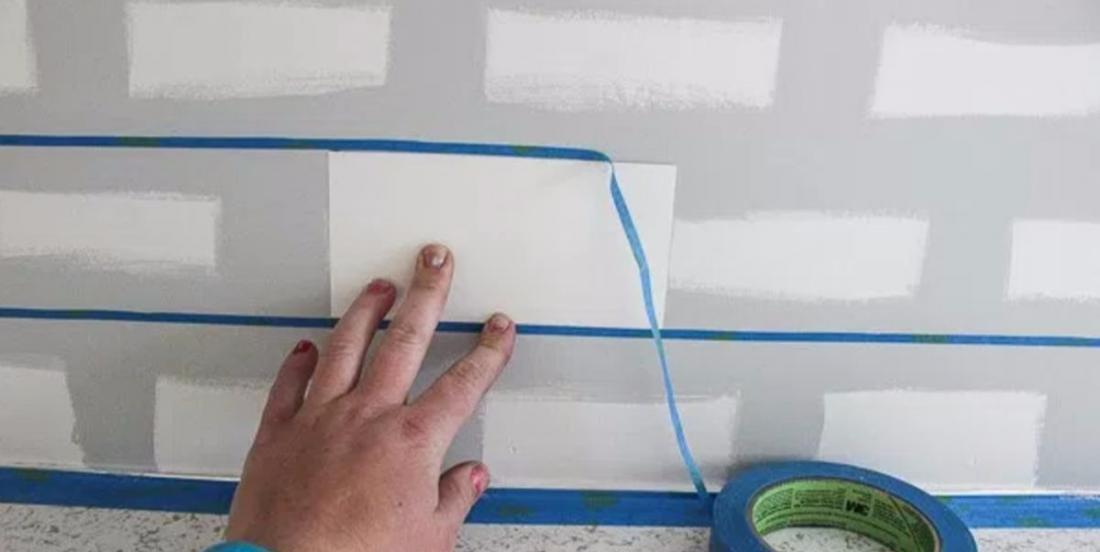 She sticks tape on her wall, she creates the decor she wanted ... for only $28!