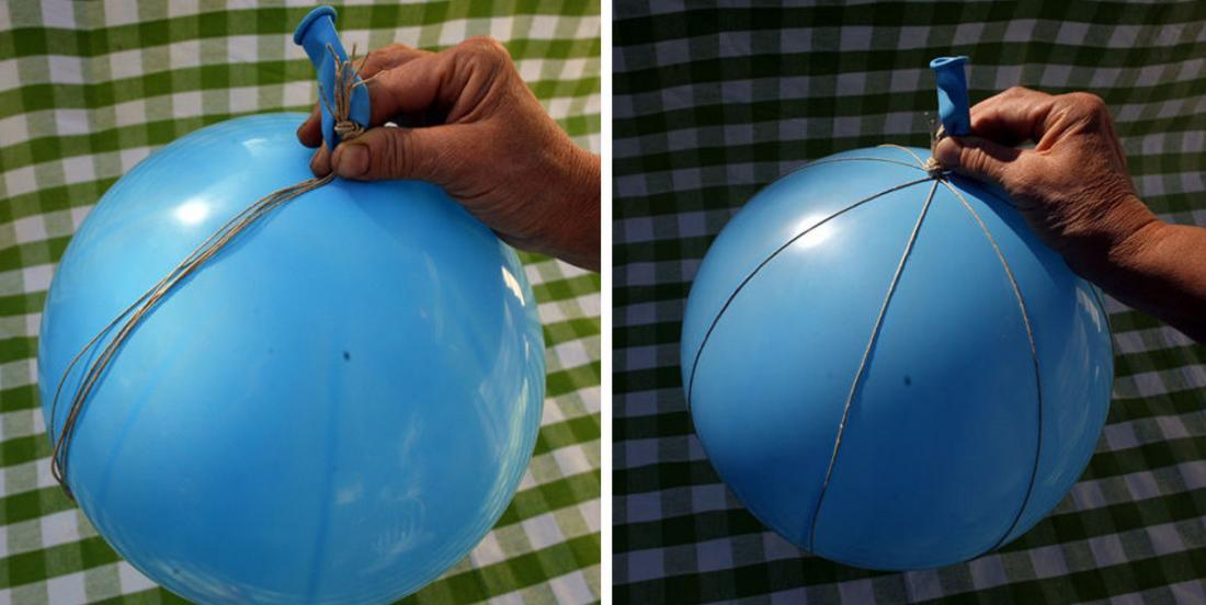 He blows up a big balloon and circle it with 4 pieces of rope! When he's done, his DIY is perfect!