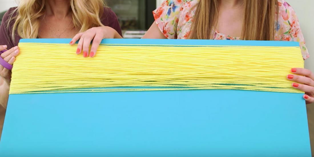 Just by winding yarn around a large piece of cardboard and a few quick braids... they realized the dream of a little girl!
