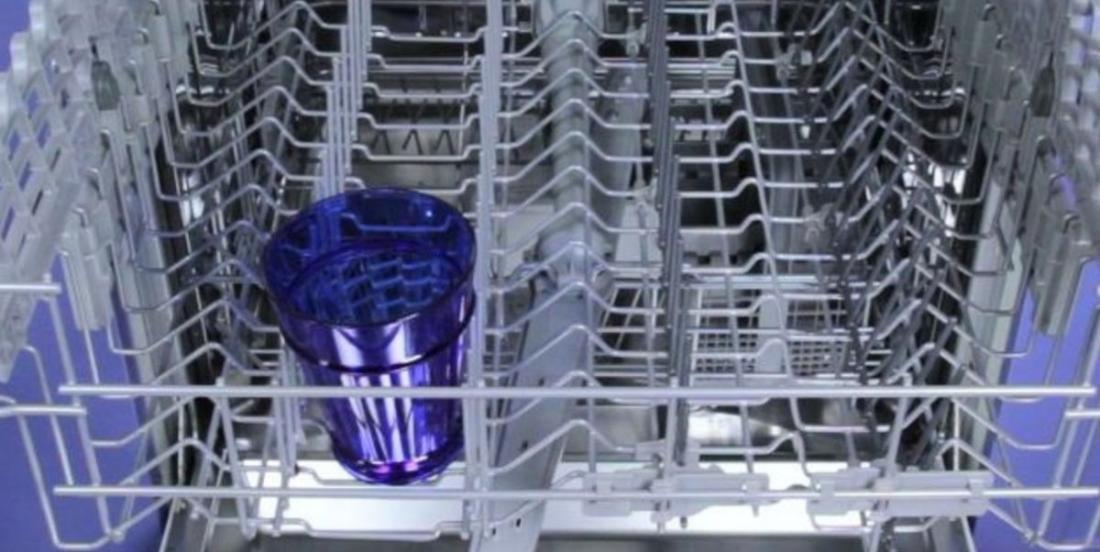 She places a glass in the upper basket of the dishwasher. What she does next is an example to follow!