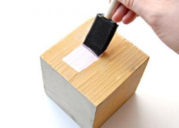 She applies some glue on a wood block ... His gift idea is the best one out there!