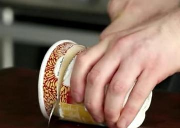With a big knife, he cuts his pot of ice-cream into several slices. His idea is fantastic!