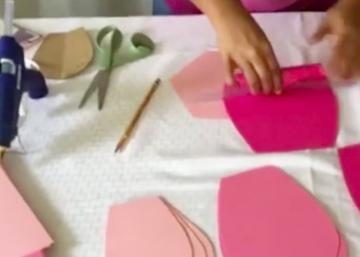 She uses a tube of hot glue to bend some colored paper! What she does is just beautiful!