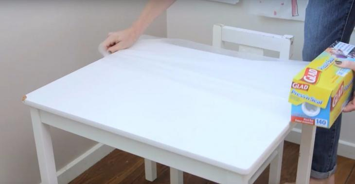 have you ever thought of covering your table with plastic wrap you should as it