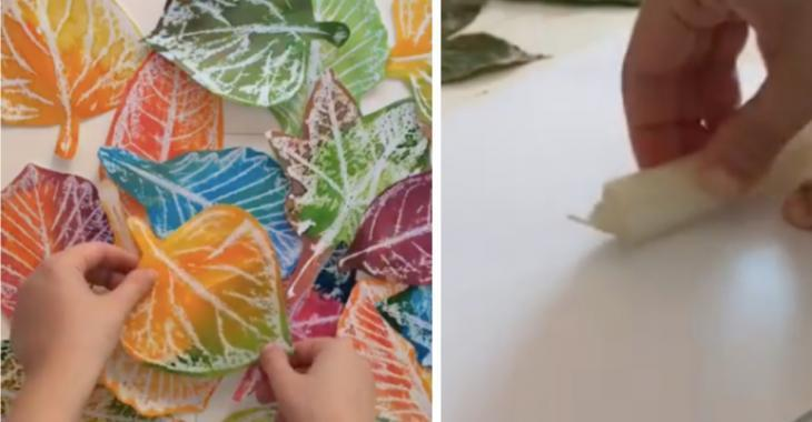 A woman rubs a white candle on her leaves to give them an even more realistic look
