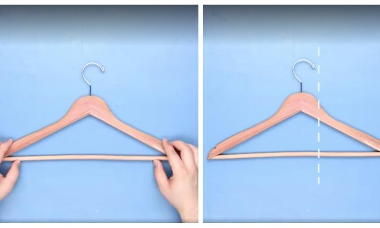 He buys wooden hangers and cuts them with a saw before using them. His idea is fantastic!