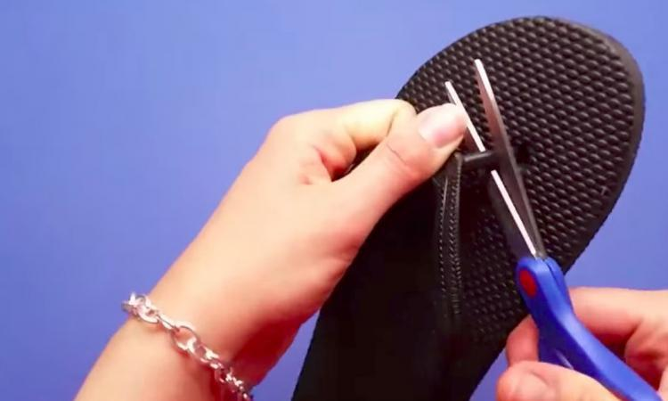 She gets a pair of flip-flops for $1.99 and cuts the strap between the toes! Her idea is simply amazing!!